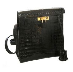 Stunning Hermes Kelly Croco Backpack Collectibe 1997 | From a collection of rare vintage handbags and purses at http://www.1stdibs.com/fashion/accessories/handbags-purses/