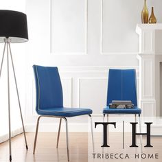 @Overstock.com - TRIBECCA HOME Matilda Blue Retro Modern Dining Chair (Set of 2) - These vinyl chairs exhibit contemporary design with contrast trim and minimalistic form. Simple chrome legs finish these modern chairs.  http://www.overstock.com/Home-Garden/TRIBECCA-HOME-Matilda-Blue-Retro-Modern-Dining-Chair-Set-of-2/7295820/product.html?CID=214117 $143.99