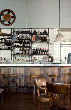 I know this is commercial, not residential, but this space is amazing. Love the open shelving and the reclaimed wood bar.