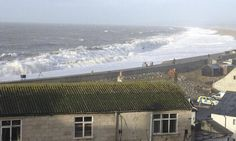 Chesil beach on Tuesday. Locals say the storm has changed the shape of the famous shingle beach, which now slopes down sharply towards the sea. Photograph: Steven Morris