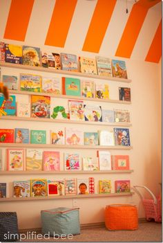 Kids' playroom with floor to ceiling book display by Simplified Bee / Photo by Savannah Franklin Photography / #playroom