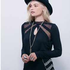 Free People Black Romantic Ruby Jane Tee Victorian inspired lightweight stretchy tee featuring high low rounded hem. High neck with sheer lace and mesh trim. Keyhole opening in front and back. Unfinished cuffs. Hand touched. Free People Tops Blouses