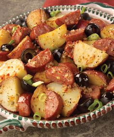Potato Salad with Sausage recipe - Hot skillet potato salad made with smoked sausage, red potatoes, ripe olives and Italian dressing. #Recipe #Sausage #Potatoes