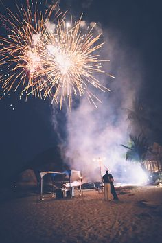 Marriage proposal with fireworks on Koh Samui. Photo by Akaphonphotography