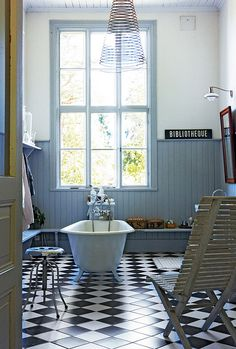 Amazing 1890 Swedish Schoolhouse Turned Into A Rustic Home : Rustic Home With White Blue Bathroom Wall Wash Basin Cabinet Chandelier Big Window Wooden Chair Ceramic Floor Mirror Lamp Design And Door Bad Inspiration, Bathroom Inspiration, Black And White Tiles, Black White, Vintage Bathrooms, Scandinavian Home, Beautiful Bathrooms, Elle Decor, Sweet Home