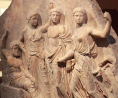 Votive relief from the Sanctuary, from left to right- Zeus enthroned, Leto, Apollo, and Artemis - about 420-400 BC, found Artemis and Iphigenia at Brauron, Attica - at the Archaeological Museum of Brauron