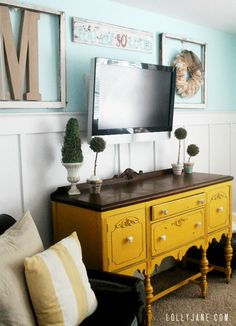 95 Ways to Hide or Decorate Around the TV, Electronics, and Cords - wall mounted tv with board and batten wainscoting and art (Lolly Jane) - Tv Furniture, Furniture Projects, Furniture Makeover, Painted Furniture, Painted Sideboard, Painted Buffet, Brown Furniture, Diy Projects, Decor Around Tv