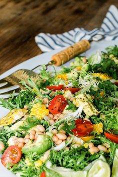 Fresh Frisee Salad with Avocado, Cherry Tomatoes, Grilled Corn & Beans