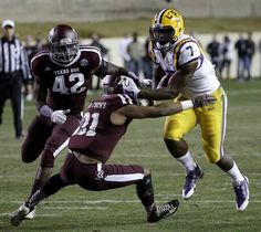 LSU running back Leonard Fournette (7) DETROYS Texas A&M defensive back Howard Matthews (31) for a touchdown run during the second quarter of an NCAA college football game Thursday, Nov. 27, 2014, in College Station, Texas. (AP Photo/David J. Phillip)