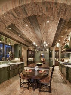 Tuscan kitchen with a brick barrel ceiling and distressed, green painted cupboards  (via Thom Oppelt: Designers' Portfolio 4287: Home & Garden Television)