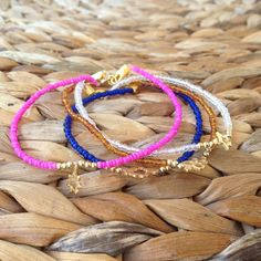 Beaded friendship bracelet with gold plated Sterling silver charms