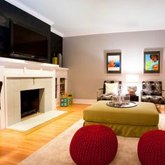 great family room. wood floors, various seating options, fireplace