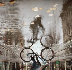 Bicycle in the rain, by Brenton Salo