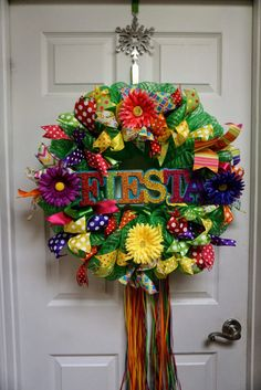 This colorful deco mesh wreath lights up your door in time for Fiesta. It is made with green deco mesh, ribbon, and flowers. The wreath measures approximately 24. Keep out of direct sunlight and rain to protect wreath from damage.  San Antonio residents can save on shipping by