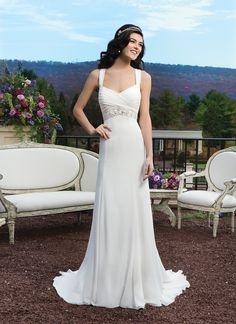Sincerity wedding dress style 3808 Chiffon straight gown with V-neckline, ruched straps and a beaded applique at the empire waist. The back features a diamond back with beaded applique, chiffon covered buttons over back zipper and a semi-chapel length train.