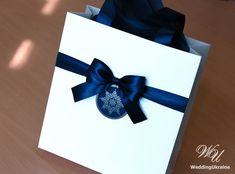 Christmas Gift Bags for guests with Navy Blue satin ribbon, bow and snowflake tag  Elegant Welcome P Wedding Favors For Guests, Wedding Welcome Bags, Christmas Gift Bags, Christmas Gift Wrapping, Holiday Gifts, Elegant Birthday Party, Birthday Party Favors, Elegant Christmas, Paper Bags