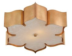 The Grand Lotus Flush Mount is a bestselling item from Currey and Company. This gorgeous lotus shaped flush mount is made of wrought iron and skillfully finished in an antique gold leaf finish. It comes with marbleized acrylic diffuser. Fixture measures 19''RD and 5''H. It takes two 26W GU24 type light bulbs. This items ships via FedEx or UPS. Click on images for greater details.