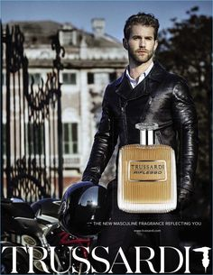 Model André Hamann fronts Trussardi's Riflesso fragrance campaign.