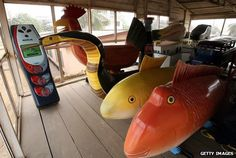 Ghanaian coffins in the shape of fish and a mobile phone