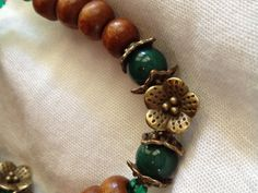 Flower Wood beaded bracelet by JewelrybyALEE on Etsy, $7.00