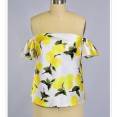 """RESTOCK ARRIVING TMRW! NWT Off shoulder lemon top ON REORDER! Beautiful off the shoulder top with lemon print. Multiple sizes available. fully lined and beautiful thick high quality fabric w a sheen. hidden zipper + elastic at back so it will fit great and stay """"up""""! 😍 not listed brand, boutique brand. Great quality at a fab price! 🍋 Small: bust 16"""" flat across front (w unstretched elastic at back) Medium: bust 17"""" flat across front (w unstretched elastic at back), Large: bust 18"""" flat…"""