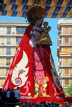 Offering flowers to the Virgin during Fallas. Valencia. Spain..