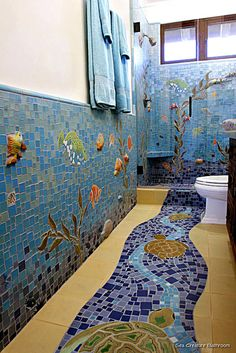 mosaic pottery bathroom. Would make a great theme for the pool bathroom