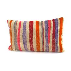 Unique and timeless these Anatolian Turkish pillows were made using vintage kilim rugs. Each pillow has its own personality based upon which portion of the rug it was cut from. This pillow features a berry spectrum of bold stripes. With close attention to detail, each pillow is lined on the kilim side, giving these vintage pieces the support they need to stay timeless treasures.  This is an old piece with repairs. #kilim #pillow