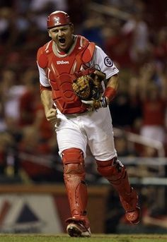 St. Louis Cardinals catcher Rob Johnson celebrates after Pittsburgh Pirates' Josh Harrison hit a ground out with the bases loaded to end the top of the 13th inning of a baseball game on Tuesday, Aug. 13, 2013, in St. Louis. (AP Photo/Jeff Roberson)