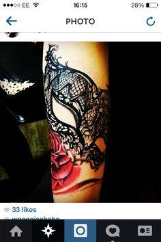 Lace mask tattoo
