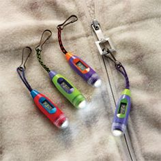 Another Pinner wrote...     Zipper-Pull Watch/Light, Safety Light, LED Flashlight | Great for Camping!!