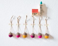 Hang anywhere ornaments!  A delicious color combo, these cheerful sorbet coloured acorns were made with needle felted pure merino wool and real acorn caps that I have picked from the lovely woods nearby my house.  I`m a lot into fall and everything it brings, all the beautiful changes the nature goes through, so why not bring some inside?  These wool acorns are meant to bring just a little bit of that into your home:)  .........................  I love them just as they are, used for a n...