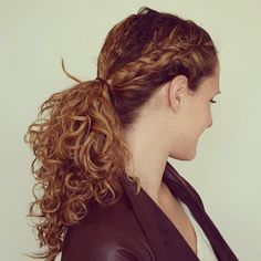 curly ponytail with a side braid