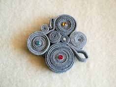 Rolls of denim strips to make original brooches, pendants, decorations on hair clips or on shoes. Love the small beads glued to their centres to add a touch of bling. Use your imagination so each one is unique.