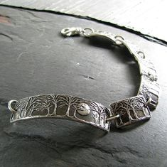 A beautifully shining moon and trees in fine silver, pressed in recycled 99.9% pure silver from my original carving. $192