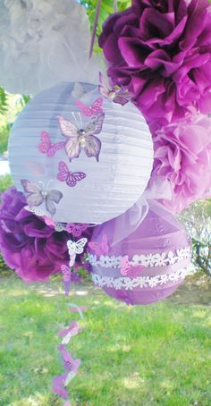Purple pom poms and paper lanterns radiant by DellaCartaDecor