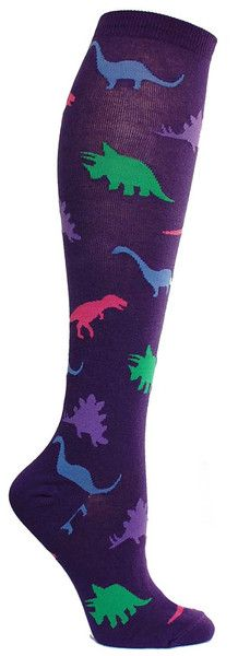 Dinosaurs may be extinct, but you will live forever in the minds of people who see you wearing these rad knee high socks. Knee high socks with dinosaurs cut outs in assorted colors, available in black or purple. Fits women's shoe size 5-10.