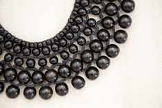 Loving this Josie Natori six layer beaded necklace made out of Filipino dark wood beads.  Order online at natori.com