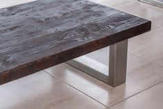 The beautifully constructed Mac+Wood Coffee Table. A reclaimed wood top with brushed steel legs.