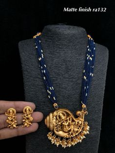Temple jewellery available at Ankh Jewels for booking msg on 9619291911 Gold Temple Jewellery, Real Gold Jewelry, Gold Jewelry Simple, Emerald Jewelry, Gold Jewellery Design, Handmade Jewellery, Silver Jewellery, Gold Earrings Designs, Necklace Designs