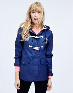 Joules Womens Rubber Coated Jacket, French Navy.                     Part of our Right as Rain collection this is the jacket to keep close to hand when rain clouds gather on the horizon.  Crafted from robust rubber coated fabric it has heat sealed seams making it 100% waterproof, while a soft jersey, nautical inspired lining ensures it's warm and comfortable too.
