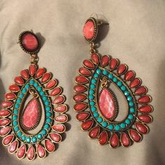 Beautiful Long Pink and Turquoise Blue Earrings This is a pair of earrings from India. Done in pink and turquoise. Hanging cabochon in the middle of the earrings. Post backing a. Please make me an offer through the offer button Jewelry Earrings