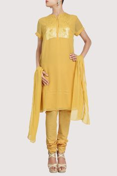Yellow georgette suit with sequins detailing on the front. Shop Now: www.karmik.in/shopping/index.php