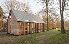 Tiny Dutch garden house with shutters by Zecc Architecten Utrecht