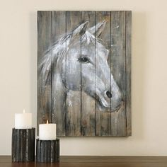 The proud profile of this majestic creature has been hand painted here on strips of old barn wood that are randomly raised to create a rough texture. Due to the handcrafted nature of this artwork, each piece may have subtle differences.