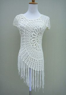 Hi Low Fringe crochet top with cap sleeve Perfect to creat a hippie boho chic look or as beach cover up with your favorite crochet bikini set  Measurement: Bust: 34-36 Length: 17 to 24 without tassels  Crocheted in easy care acrylic yarn, machine wash cool, gentle cycle, and short machine dry, low heat, or roll in a towel to remove excess water and lay flat to dry.  Please be sure to read my policies before purchasing. Feel free to let me know if you need a different color or size. thank you