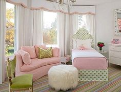 Big girl sofa, pretty drapes. Love the striped carpet!