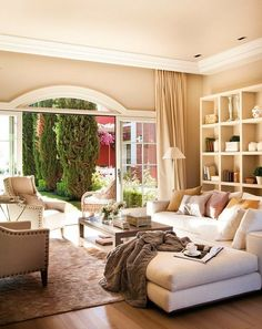 Open livingroom with cream color palette.  This looks so comfortable and fabulous.