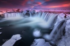 """The Waterfall Kingdom of Godafoss, Iceland - Located at Bárðardalur, feast your eyes on one of the most spectacular and must see place in North Iceland. This was taken on a snowy-spring visit last April.   Took the ring road and got stranded in Egilsstaðir on our way to Akureyri as they closed highway1 due to snow storm. As the saying goes, """"There's always light after the storm"""". Lucky me! Cheers!!"""