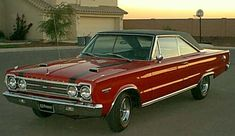 """1967GTX. The GTX was to be an exceptional blend of style and performance. What differentiated it from a normal Belvedere was its special grille and rear fascia, shared with the Satellite, as well as mock hood scoops, chrome """"pit stop"""" fuel filler cap and optional racing stripes. For the performance aspect of the vehicle, a heavy duty suspension system was made standard. Standard too was Plymouth's 440cuin (7.2L)V8called the """"Super Commando 440"""". The engine was rated at 375hp (280kW)…"""